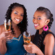Young beautiful African womans holding a glass of champagne - PhotoDune Item for Sale
