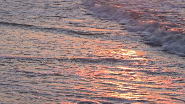 Sea Waves and Sunny Reflections