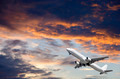 Airplane flying in a cloudy sky - PhotoDune Item for Sale