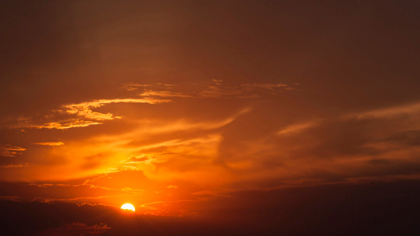 Sunset In Cloudy Sky