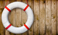 Lifebuoy on a wooden wall - PhotoDune Item for Sale