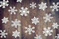 Christmas background with various paper snowflakes on wooden surface - PhotoDune Item for Sale