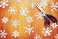 New Year background with paper snowflakes on wooden surface - PhotoDune Item for Sale