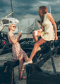Two beautiful young women are talking on pier - PhotoDune Item for Sale