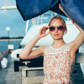 Blonde girl in flower dress and sunglasses holding  boat sails - PhotoDune Item for Sale