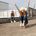 Two young  longboarding girl friends - PhotoDune Item for Sale