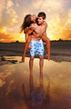 Couple on the beach at sunset - PhotoDune Item for Sale