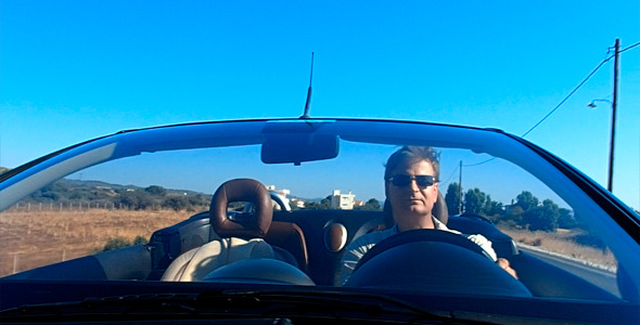 Man Driving With Open Top