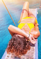 Sexy woman tanning on sailboat - PhotoDune Item for Sale