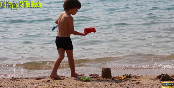 Kid Playing At The Beach