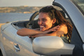 Happy girl sitting in a car - PhotoDune Item for Sale