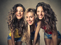 Three friends smiling to the camera - PhotoDune Item for Sale