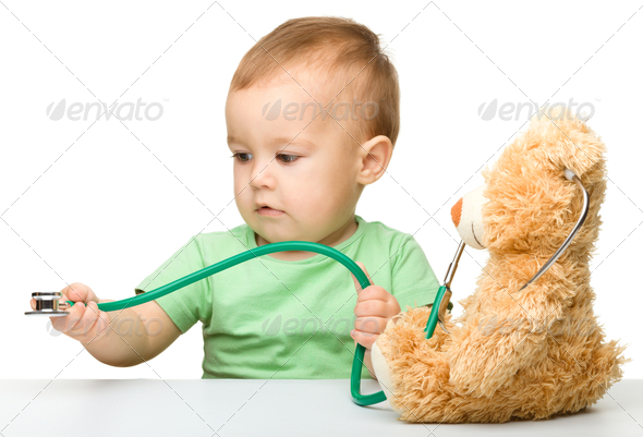 Little boy is playing doctor with stethoscope - Stock Photo - Images