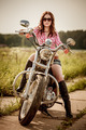 Biker girl sitting on motorcycle - PhotoDune Item for Sale