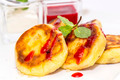 cheesecakes with sour cream and jam on table in restaurant - PhotoDune Item for Sale
