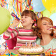 happy daughter and mother with trumpets and balloons on birthday - PhotoDune Item for Sale