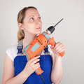 Young woman with drilling machine in her hands - PhotoDune Item for Sale