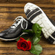 black man's shoes and rose - PhotoDune Item for Sale