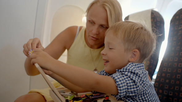 Mother And Son Playing Game In The Plane