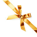 Golden satin bow ribbon on white - PhotoDune Item for Sale