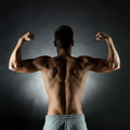 young man showing biceps - PhotoDune Item for Sale