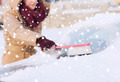closeup of woman cleaning snow from car - PhotoDune Item for Sale