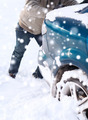 closeup of man pushing car stuck in snow - PhotoDune Item for Sale