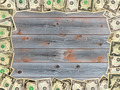 Frame from the dollars on the wooden board background - PhotoDune Item for Sale