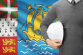 Engineer with flag on background - Saint-Pierre and Miquelon - PhotoDune Item for Sale