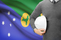 Engineer with flag on background - Christmas Island - PhotoDune Item for Sale