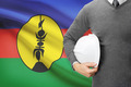 Engineer with flag on background - New Caledonia - PhotoDune Item for Sale