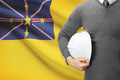 Engineer with flag on background - Niue - PhotoDune Item for Sale