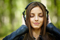 Girl listening music outdoor - PhotoDune Item for Sale