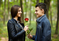 Teenager giving a flower to his girlfriend - PhotoDune Item for Sale