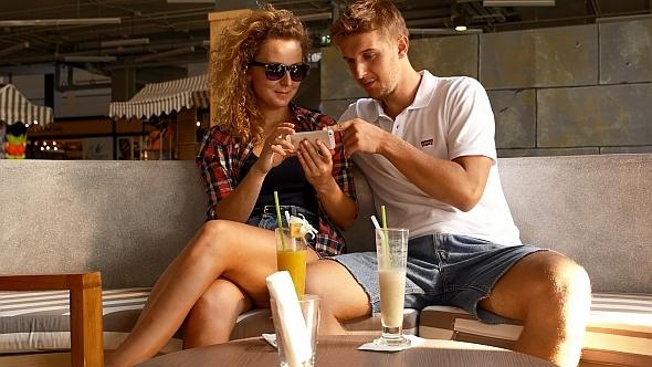 Fashion Couple Using Phone