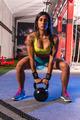 brunette girl kettlebell swing weightlifting - PhotoDune Item for Sale