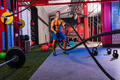 battling ropes man at gym workout exercise - PhotoDune Item for Sale