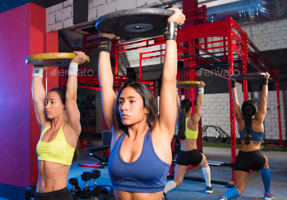 Gym women barbell plates rising workout