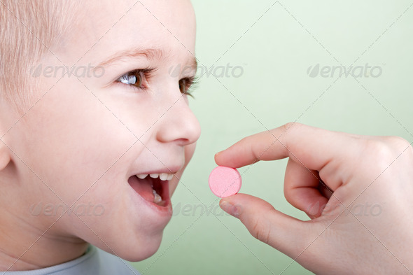 Child pill - Stock Photo - Images