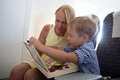 Mother and son playing together in the plane - PhotoDune Item for Sale
