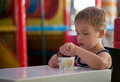 Little child eating chocolate ice cream - PhotoDune Item for Sale
