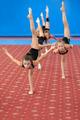 Young female gymnasts doing vertical leg-split - PhotoDune Item for Sale