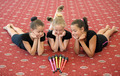 Three girls on the floor looking at Indian clubs - PhotoDune Item for Sale