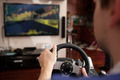 Man playing racing game with steering wheel simulator - PhotoDune Item for Sale