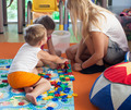 Doing puzzle with tutor in nursery - PhotoDune Item for Sale