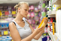 Woman looking at shampoo bottle in the store - PhotoDune Item for Sale