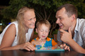 Happy family with tablet PC outdoor in the evening - PhotoDune Item for Sale