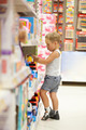 Boy watching cars in the toy shop - PhotoDune Item for Sale