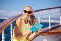 Happy woman with pad during sea traveling - PhotoDune Item for Sale