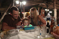Parents and child with tablet PC in outdoor cafe - PhotoDune Item for Sale